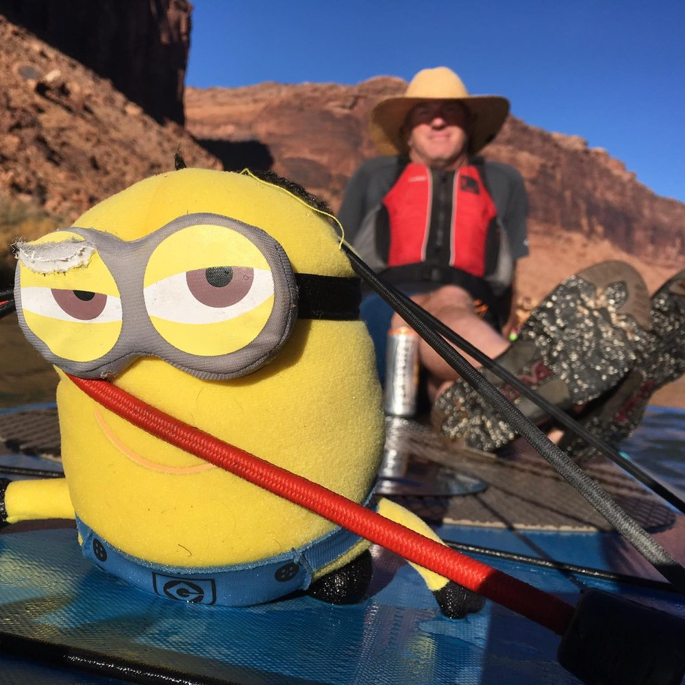 Rob and his Minions relaxing while I tow them down the Colorado.  [Ph: Nola Svoboda]