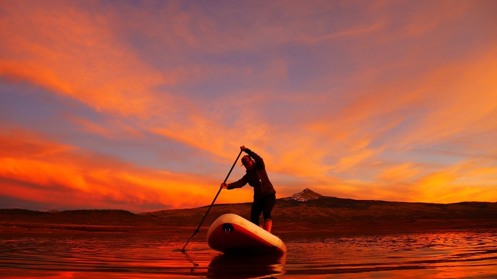 Sunset SUP sessions at Miramonte Reservoir near Norwood, Colorado can be quite spectacular!  [Ph: Nola Svoboda]