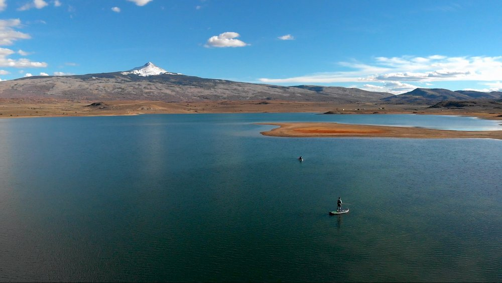 Stand up paddle boarding fly fishing on Miramonte Reservoir near Norwood Colorado