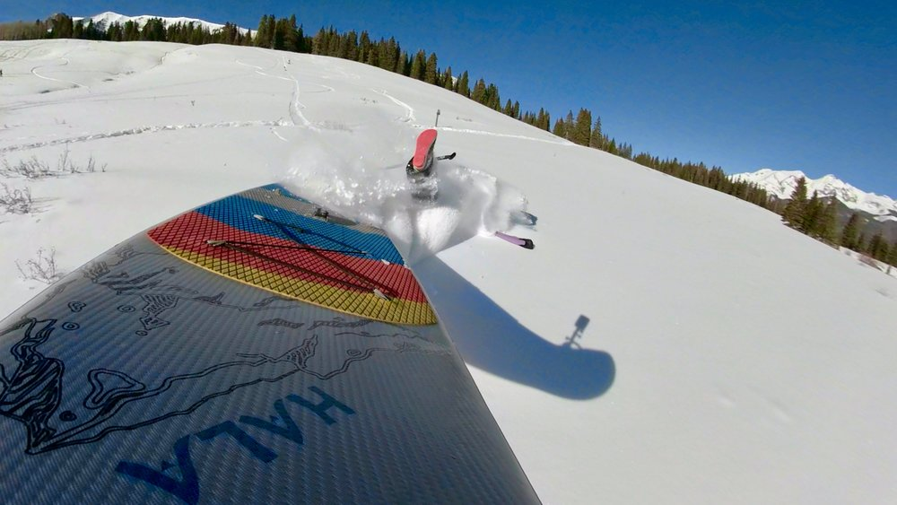 Stand up paddle board snow SUP wipe out in the San Juan Mountains on Lizard Head Pass near Telluride Colorado