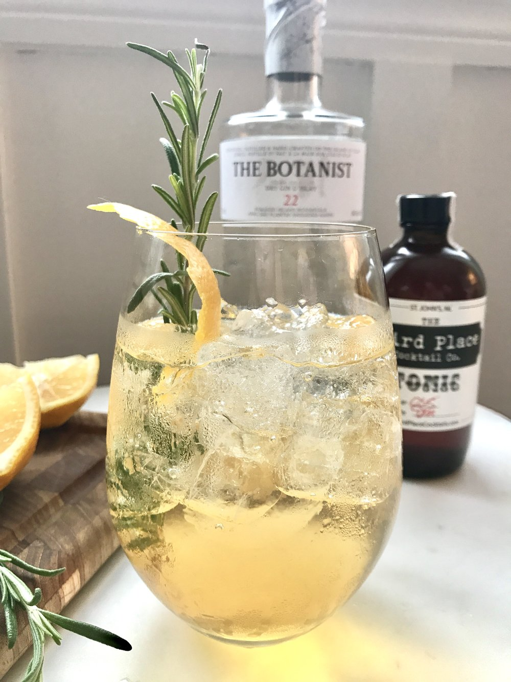 _______________2 Parts Soda Water2 Parts Gin1 Part TonicLemon ZestRosemary Sprig_______________ -