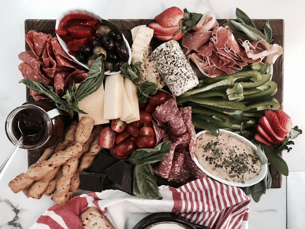 charcuterie board salami proscuitto peppers hummus olives foodie food blog what to eat newfoundland cheese meat board
