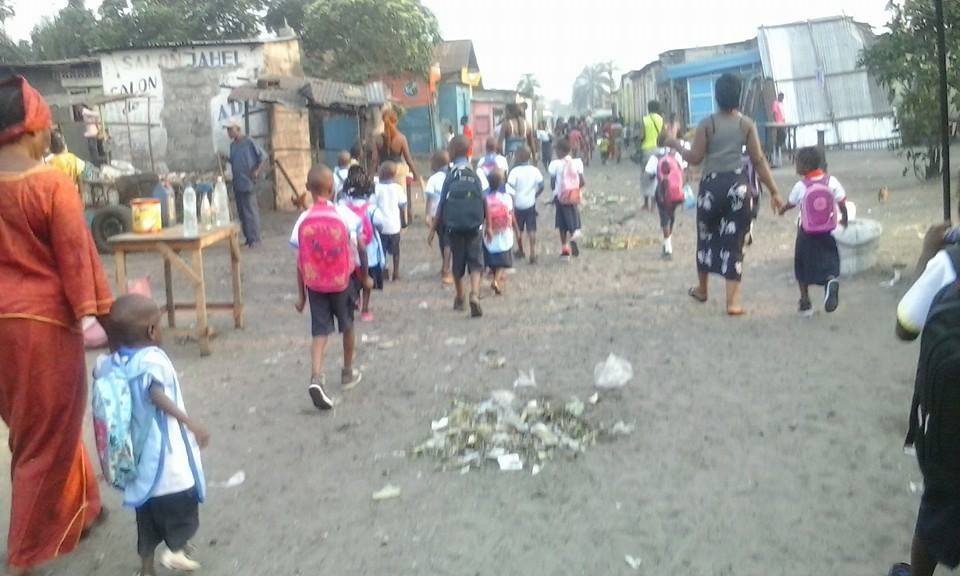 The children from Amiband orphanage walking to school.