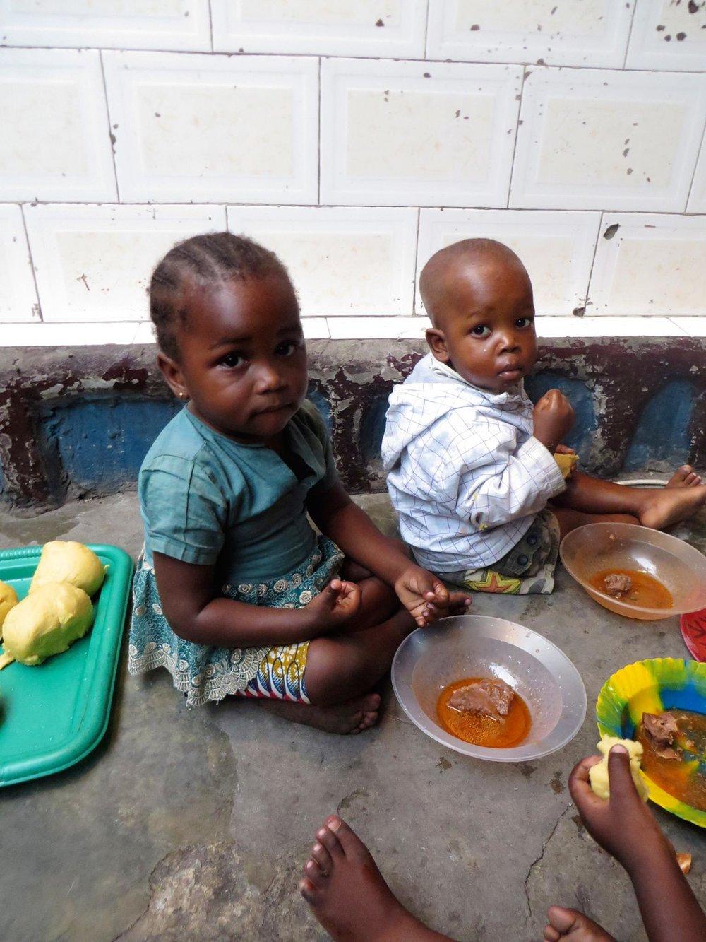 Children eating at the Amiband orphanage.