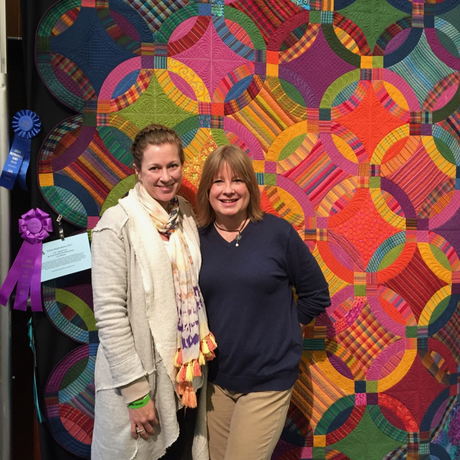 Empire Quilt Show - Manhattan, NY (2017) - My First Double Wedding Ring pieced by Lisa Mason & quilted by Rachael DorrWon 4 Awards: Best in Show, Viewers Choice, Overall First Place & Best Use of ColorImage: Lisa & Rachael infant of My First Double Wedding Ring