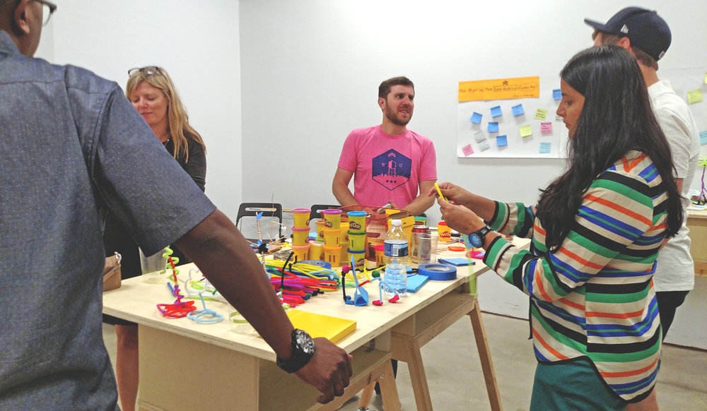 Visitors at Wily's open house build ideas for making Camp North End a creative hub.