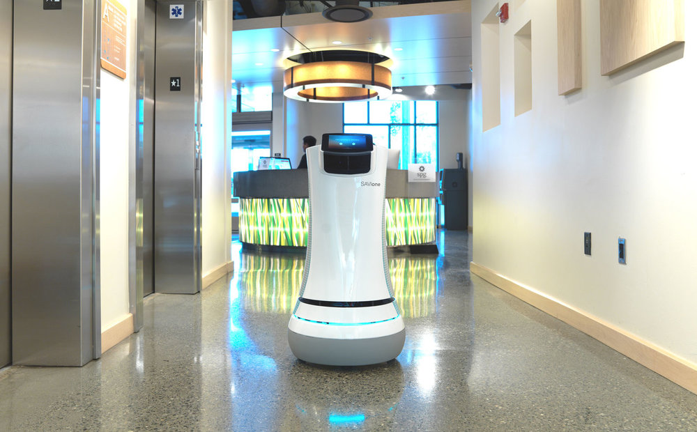 The SaviOne robot delivers items to hotel guests. It was created in part using Design Sprints.  (This photo is owned by  Savioke , the firm that designed the SaviOne robot in the picture).
