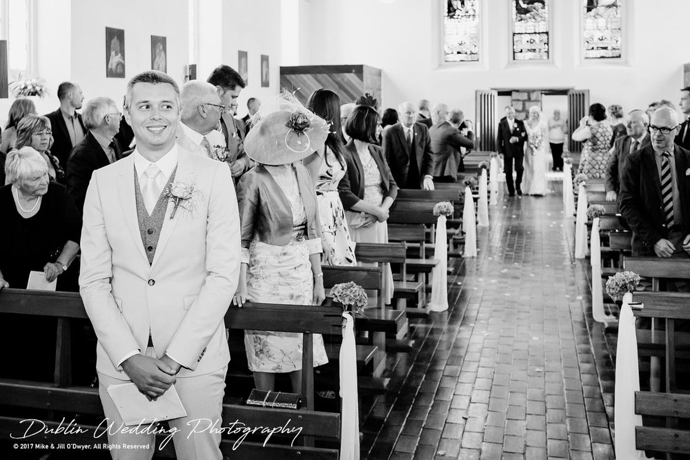 15-niamhcarl.jpgWedding Photographer Carlow Groom at the Top of the Aisle Waiting
