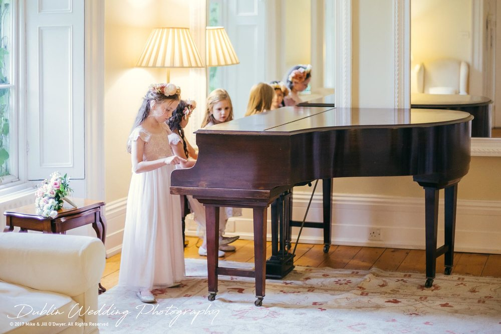 Trudder Lodge Wedding Photographers Kids Playing on the Piano