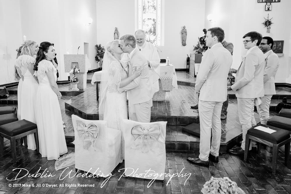 Wedding Photographers carlow Bride and Groom Kiss in the Church