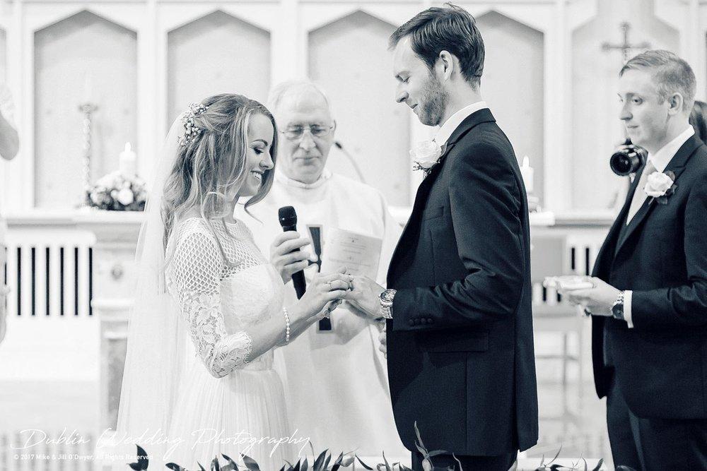 Wedding Photographer Dublin Bride & Groom exchanging rings