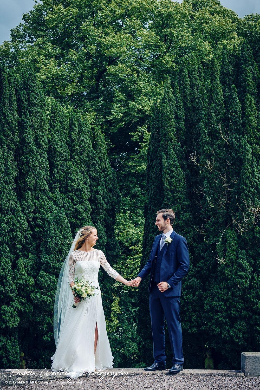 Wedding Photographers Dublin castle leslie Bride and Groom facing each other