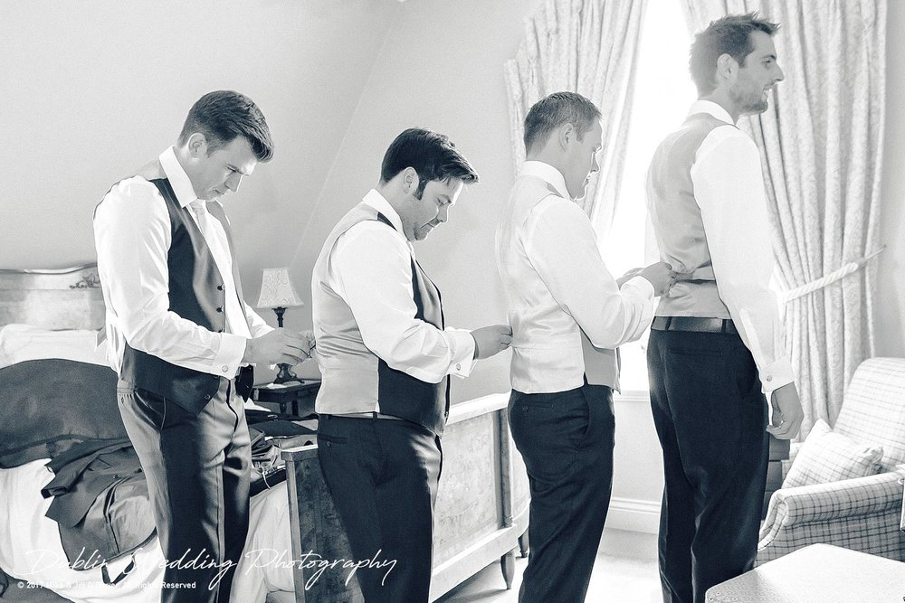 Chris, The Groom, and the Groomsmen helping each other get ready