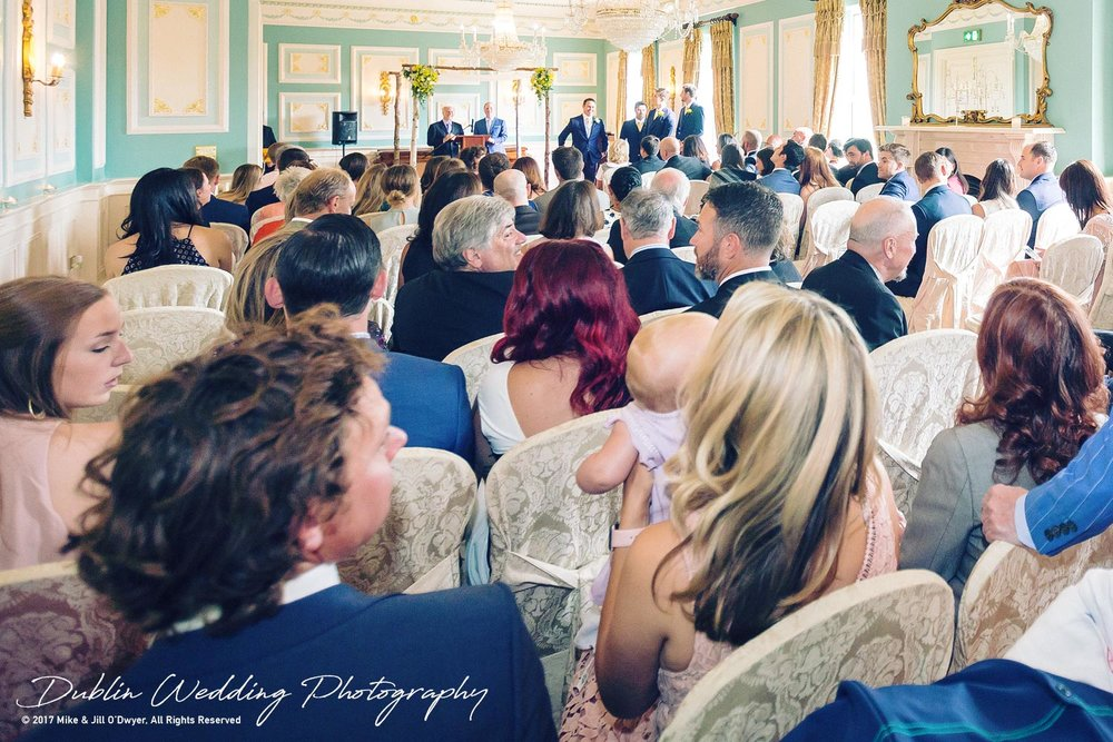 Wedding Photographers Killashee Hotel Ceremony Room with Guests