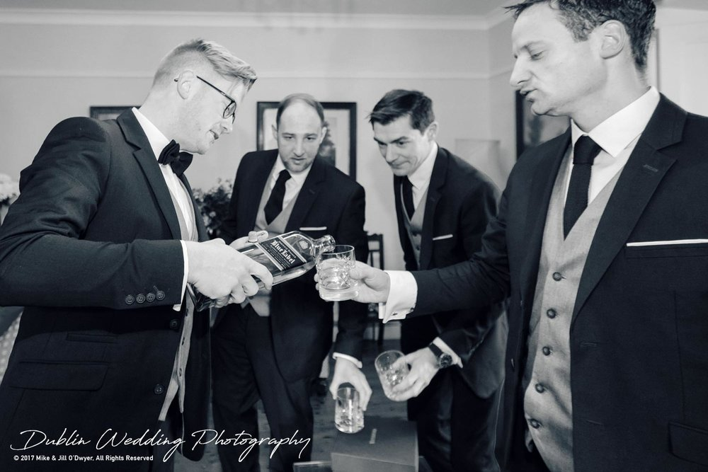 Tinakilly House Wedding Photographer: Groomsmen and Groom and Whiskey