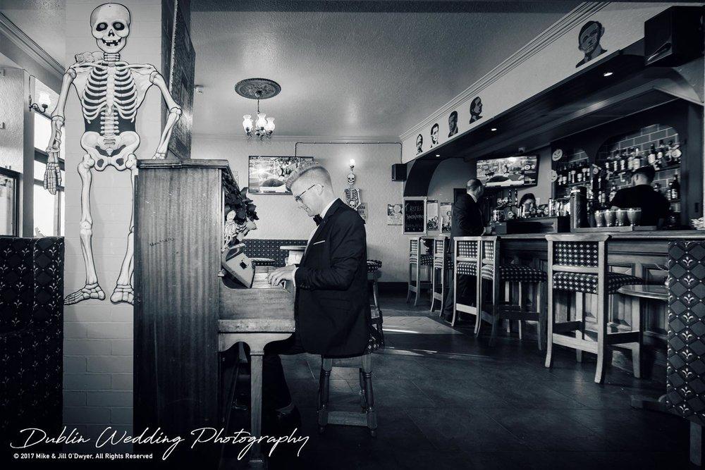 Tinakilly House Wedding Photographer: Groom on Piano
