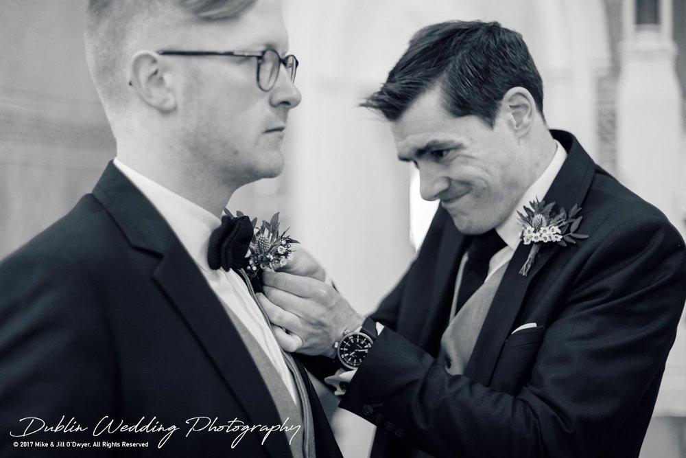 Tinakilly House Wedding Photographer: Groomand Groomsman Putting in Flower