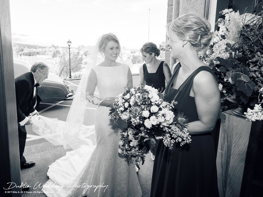 Tinakilly House Wedding Photographer: Bride Outside Church with Bridesmaids and Father
