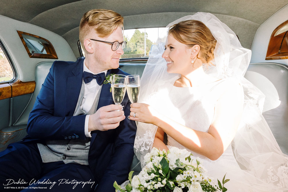 Tinakilly House Wedding Photographer: Bride & Groom in Car at Church with Champagne