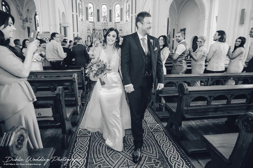Moyvalley, Balyna House, Wedding Photographer, Kildare, Dublin, Groom walking Bride out of the Church Aisle