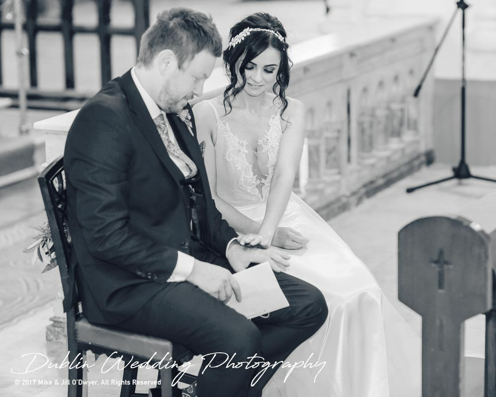 Moyvalley, Balyna House, Wedding Photographer, Kildare, Dublin, Groom Bride in Church looking at rings