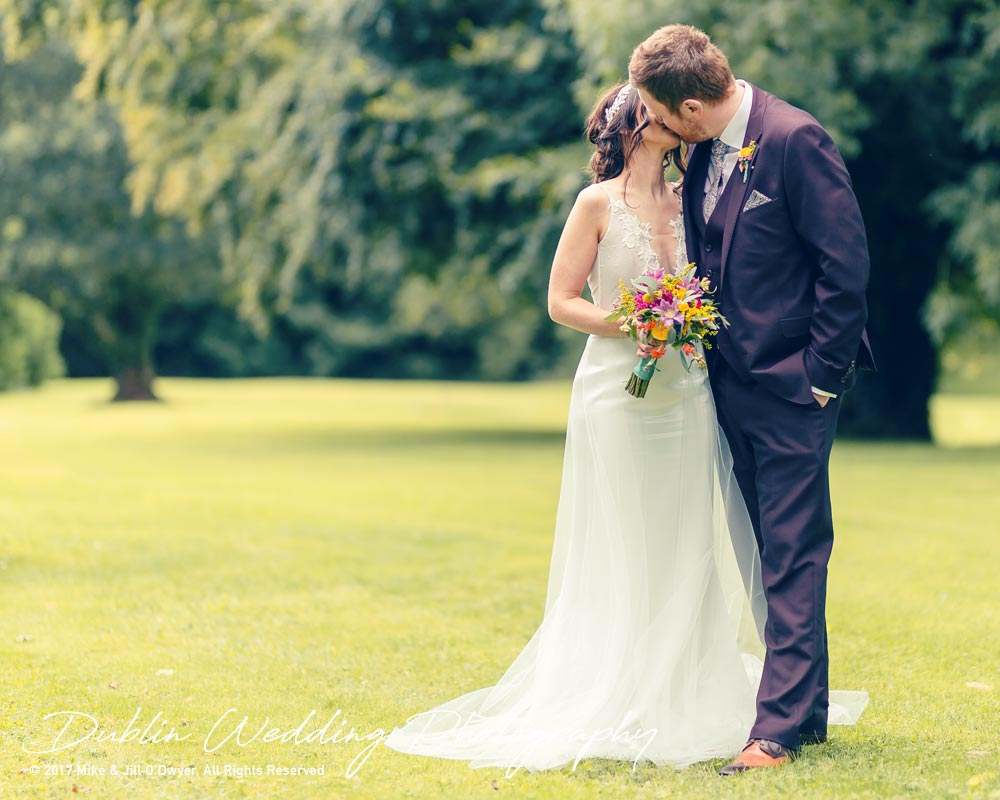 Moyvalley, Balyna House, Wedding Photographer, Kildare, Dublin, Beautiful Bride & Handsome Groom Standing together and kissing