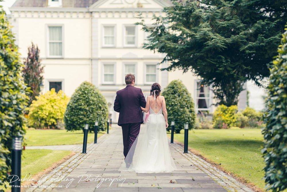 Moyvalley, Balyna House, Wedding Photographer, Kildare, Dublin, Bride and Groom walking towards Balyna House