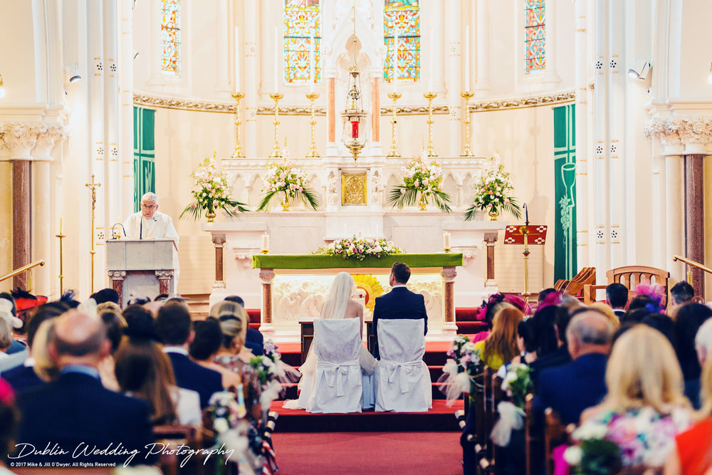K Club, Kildare, Wedding Photographer, Dublin, Bride and Groom seated while the Priest gives a speech