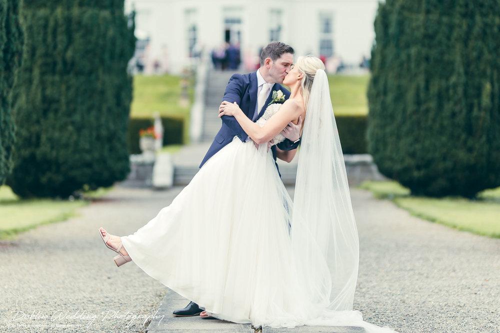 K Club, Kildare, Wedding Photographer, Dublin, The Groom kissing the Bride in the gardens