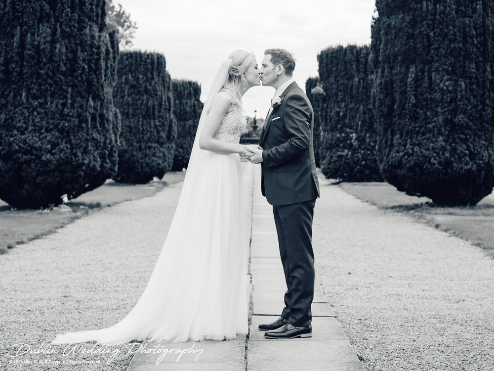 K Club, Kildare, Wedding Photographer, Dublin, The Bride and room kissing in the gardens