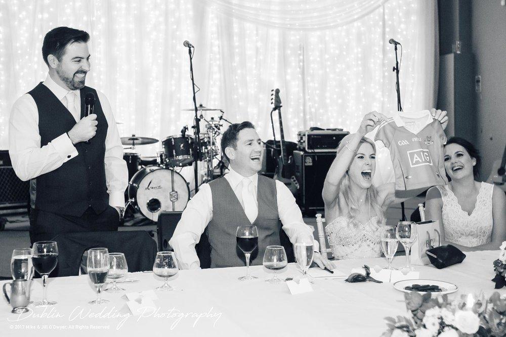 K Club, Kildare, Wedding Photographer, Dublin, Bride and Groom enjoying the speeches by the Best Man