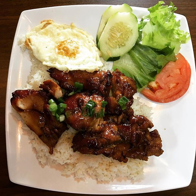 Grilled chicken rice dish with a fried egg. #omg #katytx #houston #vietnamesefood #food #hangoutasiangrill
