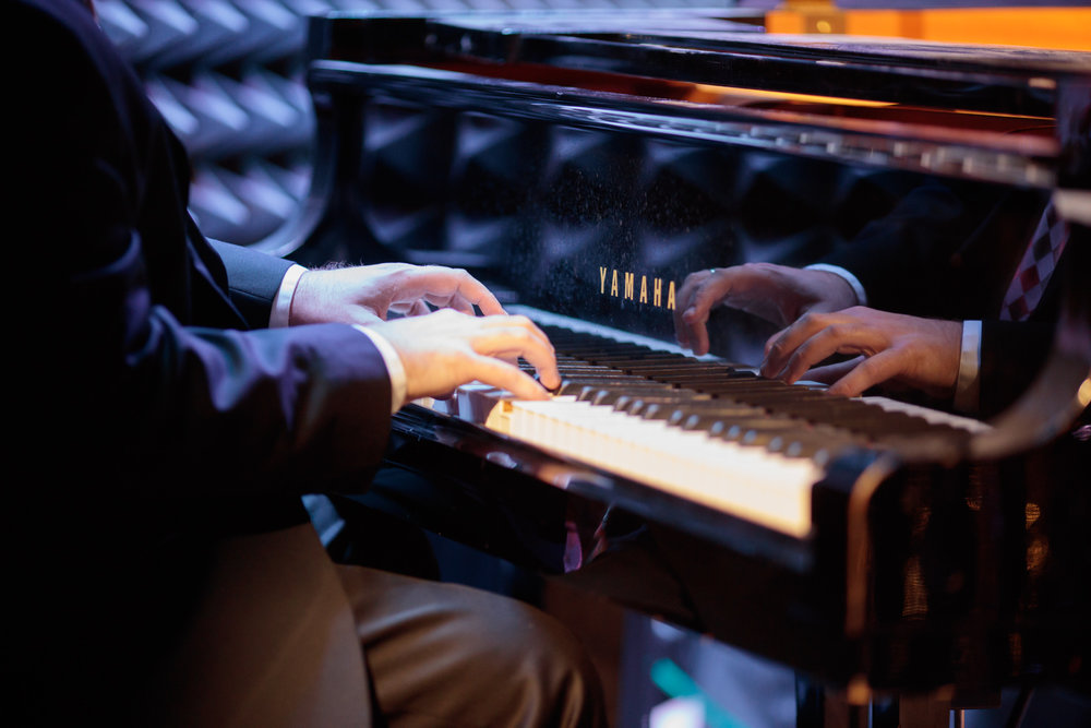 """The Parker Jazz Club """"House Band"""" is led by Ryan Davis (piano) and includes Ben Triesch (bass) and Danny Sanchez (drums). Owner and musician Kris Kimura is always sure to join the group every night and there are almost always guest musicians."""