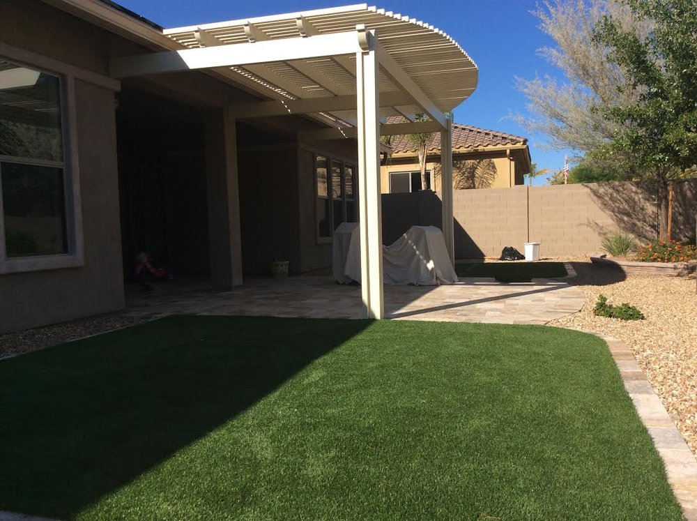 Faux Sod Pergola and Scabos Travertine.jpg