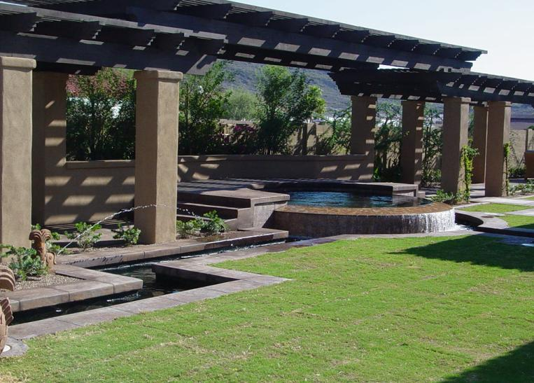 Stacked rough wood ramada over pool and raised seating area.JPG