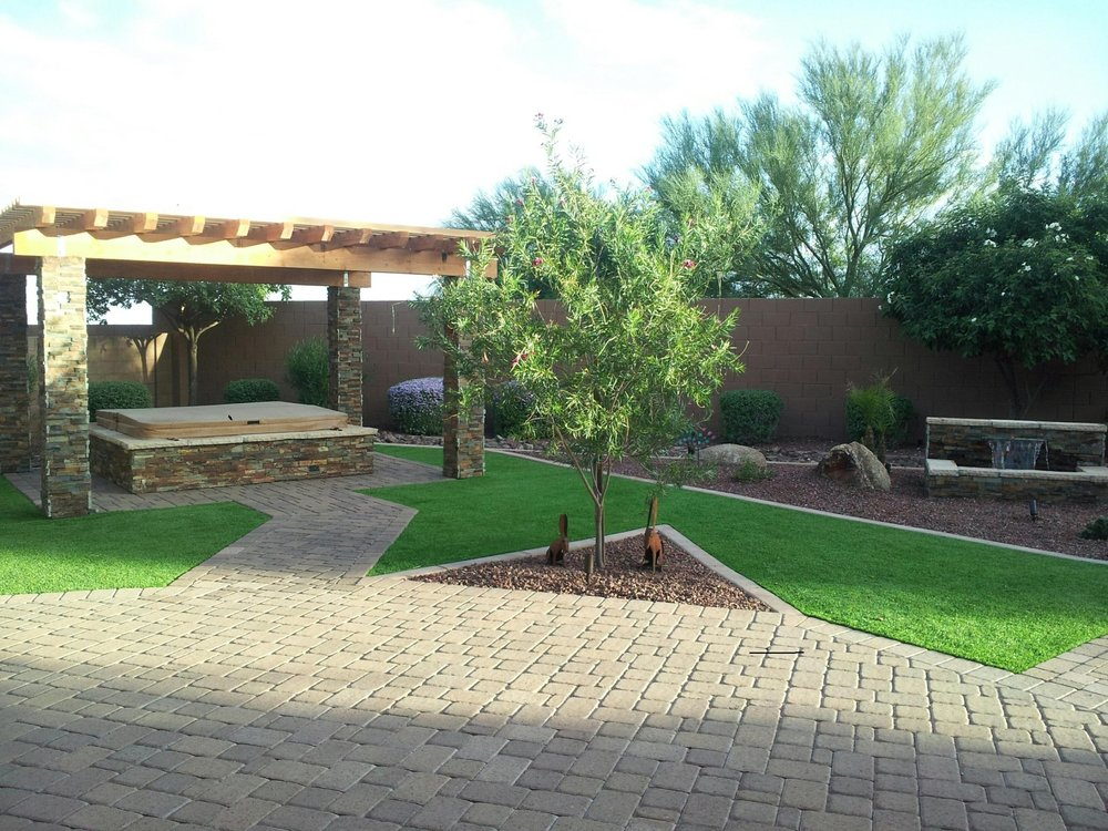 Stacked stone columns and rough wood pergola over spa.jpg