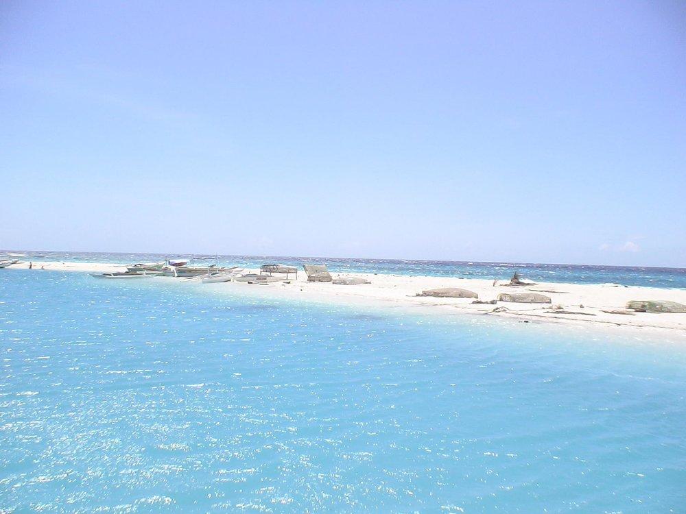 stock-photo-selinog-island-mendino-philippines-131047233.jpg