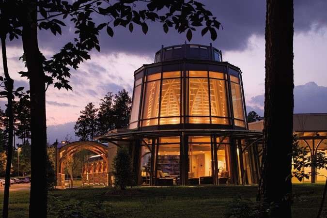 The Duke Integrative Medicine center's holistic design includes a circular library and sitting room, with soaring glass walls that open onto the surrounding forest  .