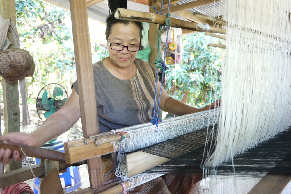 A weaver-entrepreneur who produces textiles in Pua to sell in Chiang Mai