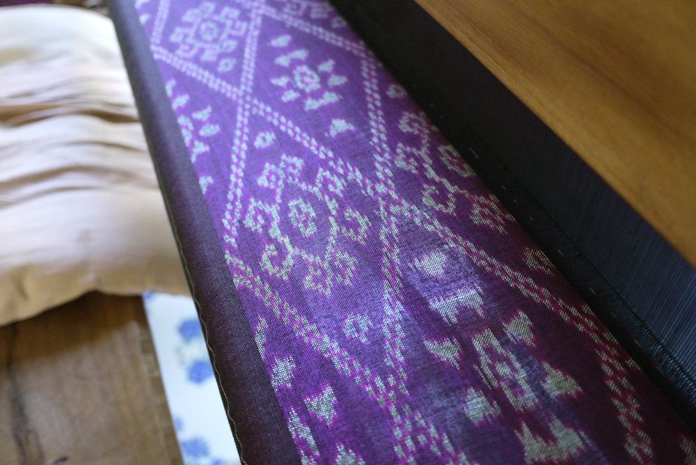 Mat Kan (weft ikat) in purple, a color that is typical for Tai Lue skirts made in Pua