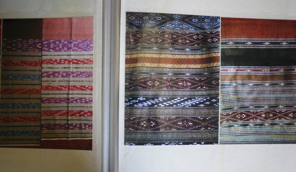 A photo album used by a weaver to remember older patterns and design structures