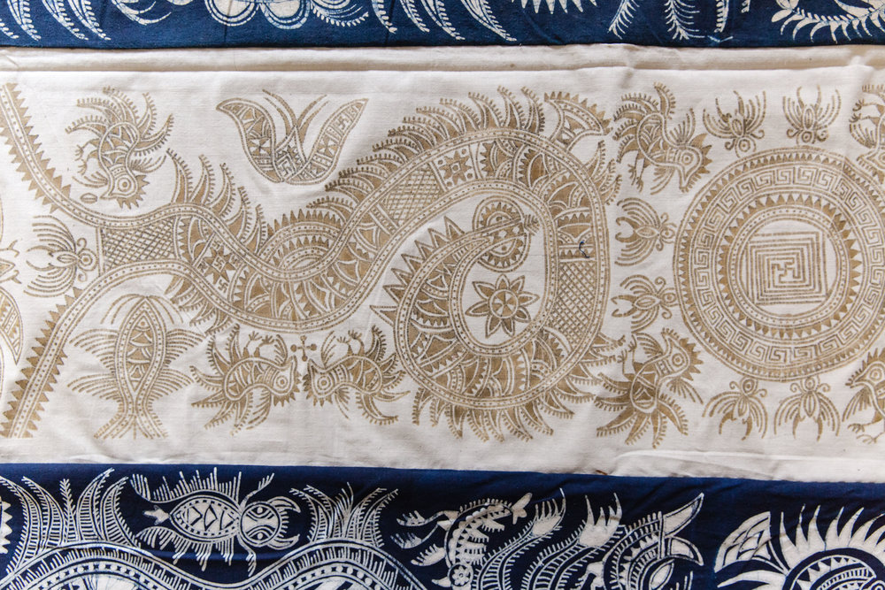 Details of newly made pre-dyed Miao batik from Kaili, Guizhou, China. Featuring patterns of the yin yang centre, surrounded by symbol of the sun, and bird, dragon and frogs.   Yang Wen Bin Collection.  Photo credit:  Stephanie Teng Photography