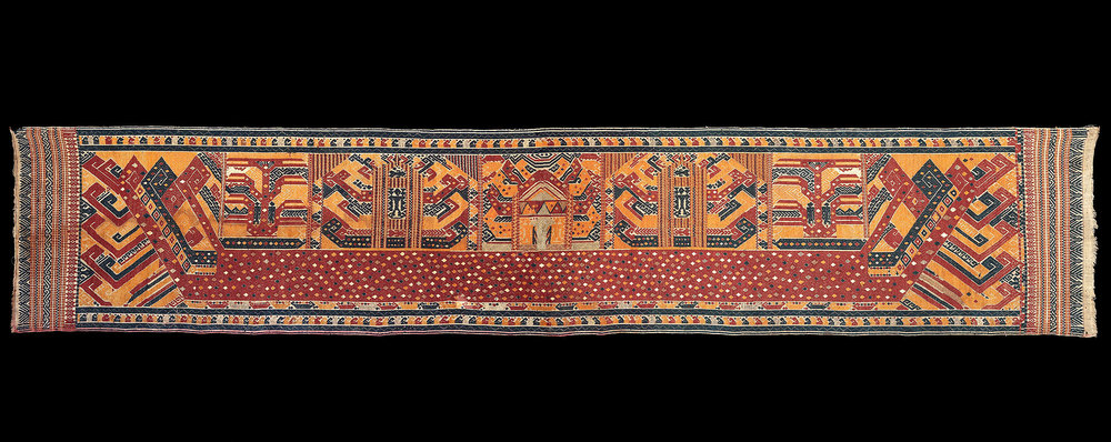 1850-1900 long Palepi, ceremonial hanging.  Made of cotton with colored thread and gold thread supplementary weft pattern of figures on large red ship. All natural dyes. Pammingir people, Kota Agung, Lampung,south Sumatra, Indonesia.   303 X 58 cm   Samyama  Collection.