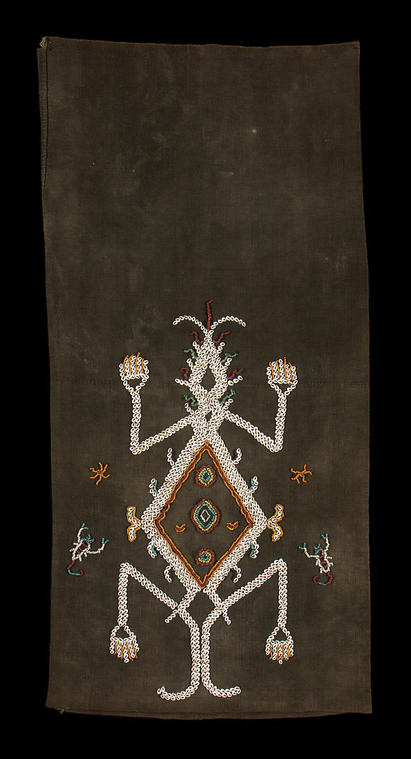 Detail of 1920s Lao Hada, woman's ceremonial tube skirt.  Made of mud dyed cotton with large lizard flanked with small scorpions embroidered of shells and beads on both sides. Natural dyes. Sumba people, east Sumba, Indonesia.     118 x 56(x2) cm   Samyama  Collection. Former Anthony Granucci Collection.