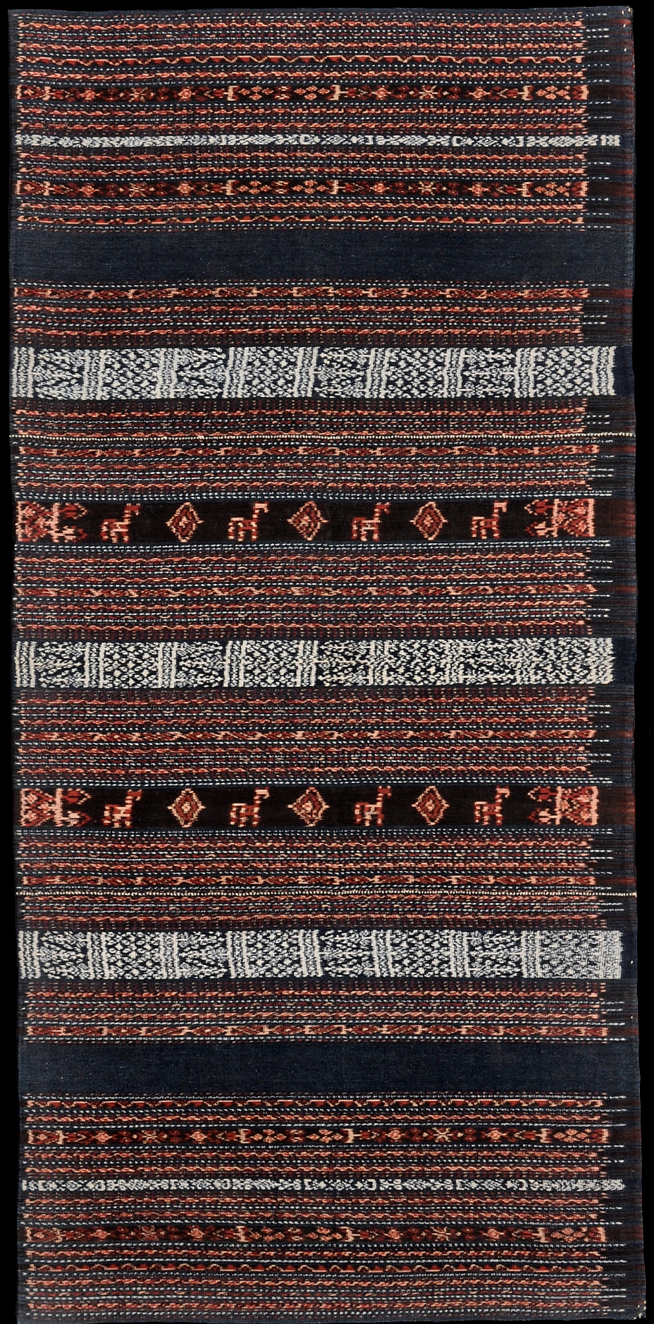 Flores, Ende Endenese people  Zawo , sarong Warp ikat in medium hand-spun cotton 1910–1930   Pusaka Collection