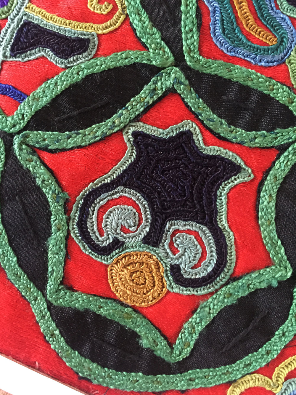 Miao embroidery with double-pulling stitch featuring guava motif from Leishan, Guizhou, China. Yang Wen Bin Collection.