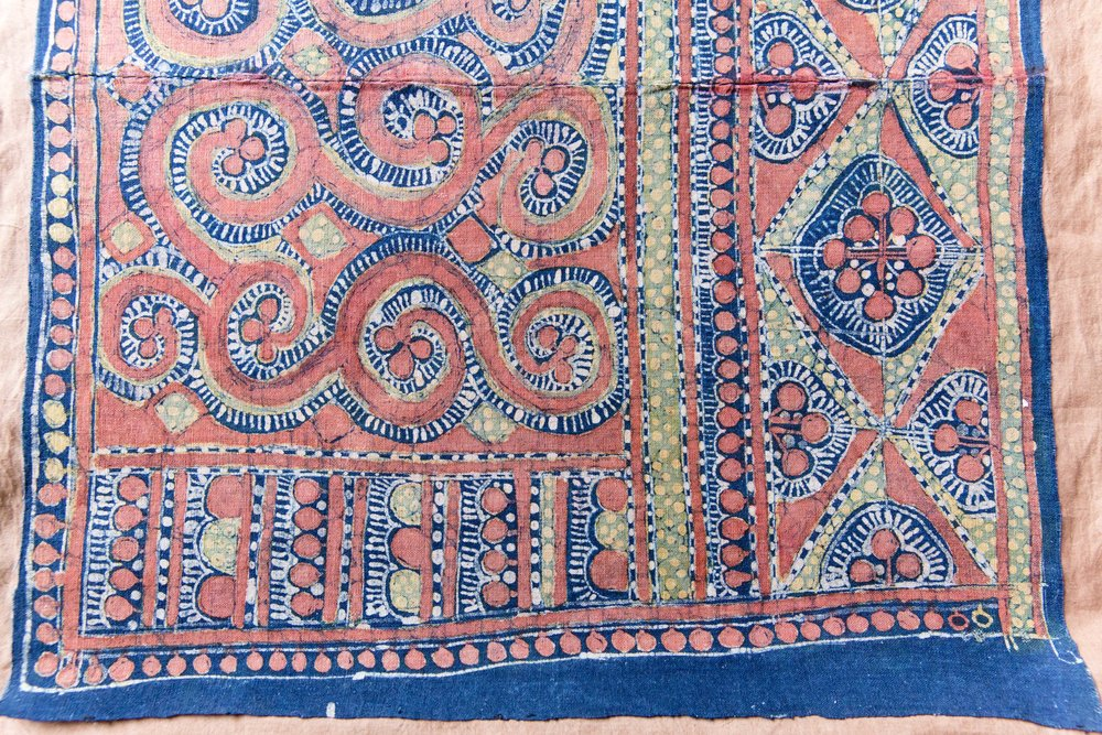 Details of Miao coloured batik baby wrapper from Anshun city, Guizhou, China. Featuring patterns of dragons.