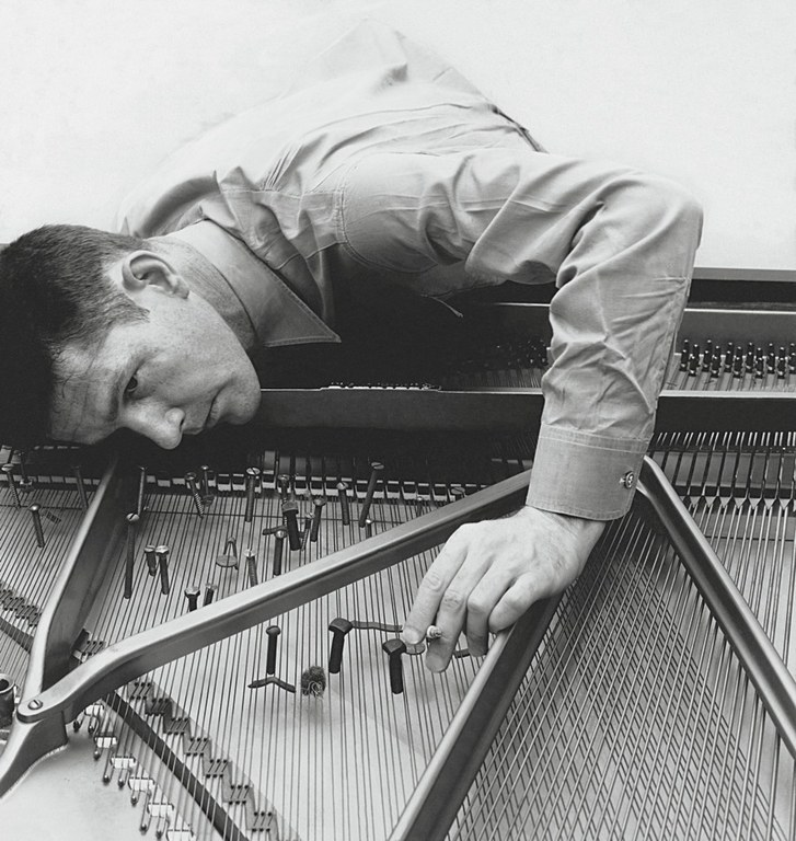 Cage preparing a piano, 1947. Image from intelligentarts.net