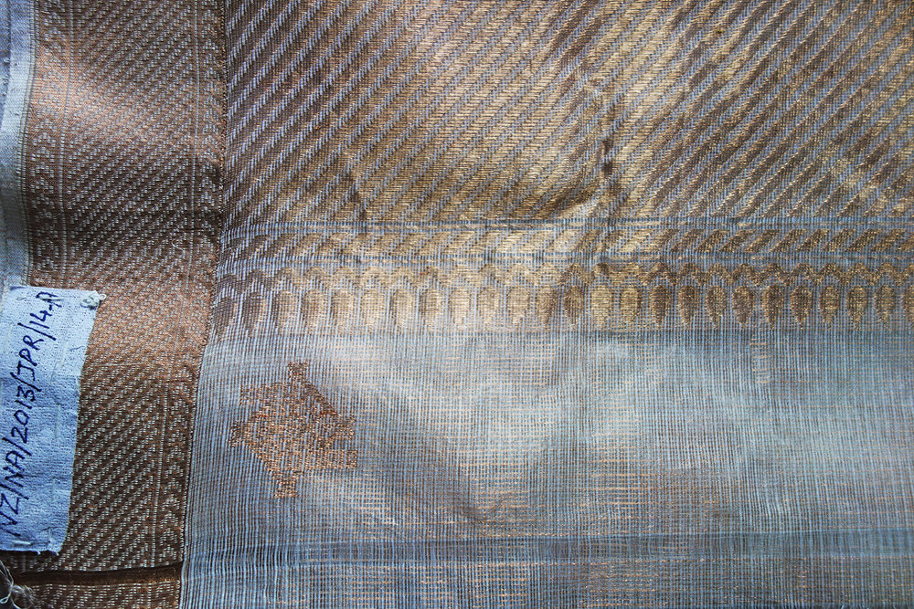The kota doria GI mark woven into the border of a sari