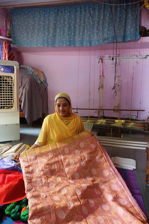 Badrun Nisha showing a sari she wove for the national award